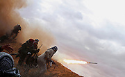 Rebels fire rockets during a battle against fighters loyal to Libyan leader Muammar Qaddafi while trying to push forward on the road from Ras Lanuf to Bin Jawad. Each time the rebels advanced Qaddafi fighters forced them to retreat...