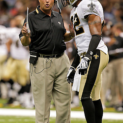 2009 August 14: New Orleans Saints defensive coordinator Gregg Williams talks with safety Darren Sharper (42) on the field during a preseason opener between the Cincinnati Bengals and the New Orleans Saints at the Louisiana Superdome in New Orleans, Louisiana.