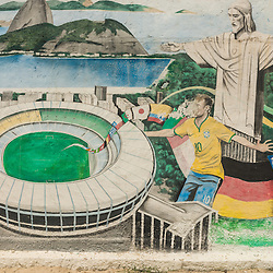 Wall painting at Copacabana beach displating Christo redentor and football images, Rio de Janeiro, Brazil.