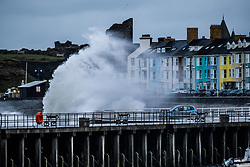 © Licensed to London News Pictures. 10/03/2019. Aberystwyth, UK. Gale force  westerly winds gusting at over 60mph , and the morning's 4.9m  high tide, combine to bring huge waves sweeping across the Irish Sea and battering into the sea defences  at  Aberystwyth on the Cardigan Bay coast in West Wales.<br />