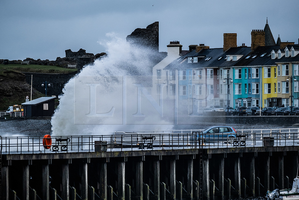 © Licensed to London News Pictures. 10/03/2019. Aberystwyth, UK. Gale force  westerly winds gusting at over 60mph , and the morning's 4.9m  high tide, combine to bring huge waves sweeping across the Irish Sea and battering into the sea defences  at  Aberystwyth on the Cardigan Bay coast in West Wales.<br /> Photo credit: Keith Morris/LNP