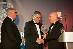 CARDIFF, WALES - Monday, October 2, 2017: Wales' Neil Taylor with FAW Fair Play Award Winner 2016/17 Huws Gray Alliance League Ruthin Town during the FAW Awards Dinner at the Hensol Castle. (Pic by David Rawcliffe/Propaganda)