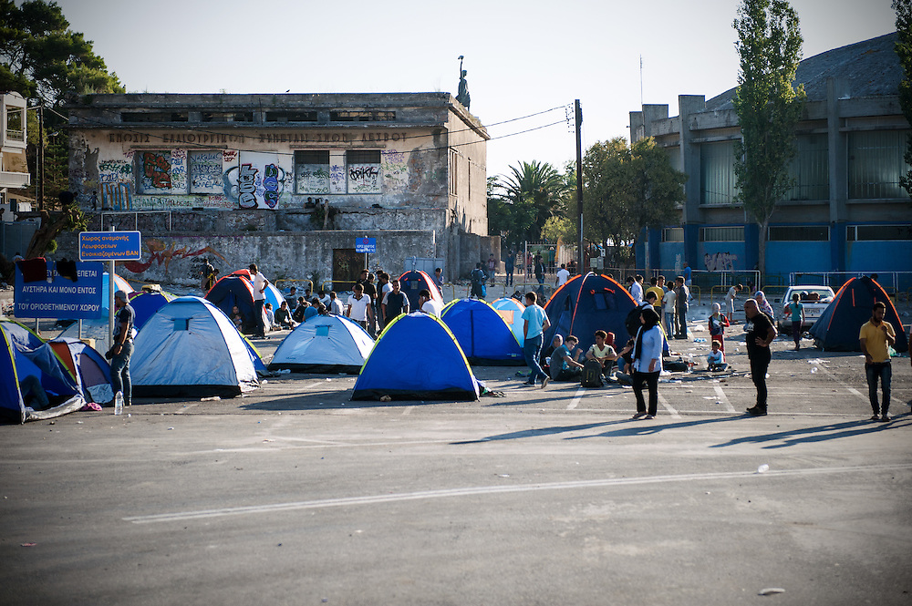 The temporary camp at the port of Mytiline. <br /> Once the refugees and migrants go though the registration process and receive a temporary document that allows them to stay in Greece for up to six months, then they wait at the port for the next available boat to the mainland.