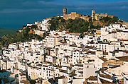 SPAIN, ANDALUSIA CASARES; a picturesque mountain village or 'pueblo blanco' near Estepona on the Costa del Sol; with castle and church above