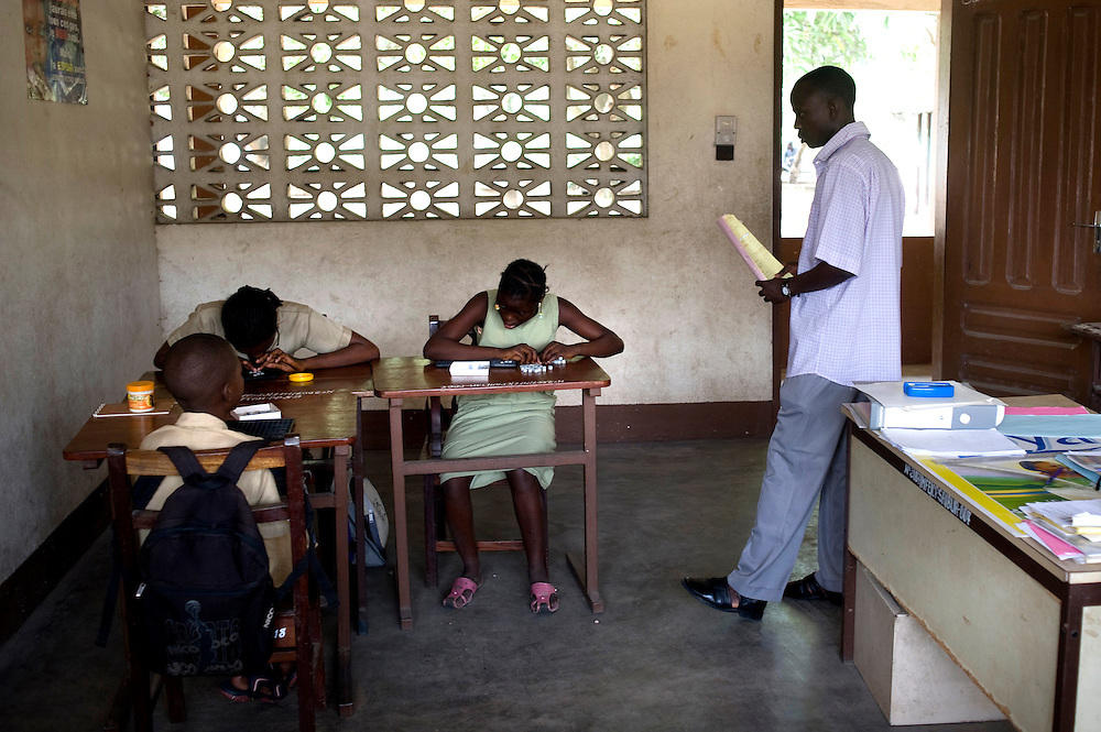 February 2008 - students at the  School for the Blind 'reads' braille in Cotonou, Benin. The School takes 80 blind students surrounding villages and at no cost to their families teaches them geography, science, math and a work for the future. Though the school belongs to the state, it receives considerable funding from ONG.