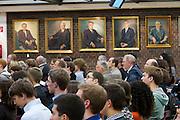 Universities in Vienna, Austria..WU (Wirtschaftsuniversität Wien)..Podium discussion at the Festsaal. Portraits of Rektors.