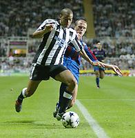 Photo. Andrew Unwin<br /> Newcastle v Partizan Belgrade, Champions League Third Qualifying Round, Second leg, St James' Park, Newcastle 27/08/2003.<br /> Newcastle's Kieron Dyer (l) holds off a challenge from Partizan Belgrade's Igor Duljaj (r).