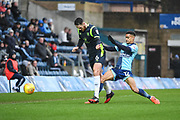 Wycombe Wanderers Forward Paris Cowan-Hall (12) and Carlisle United Defender Tom Parkes (6) battle for the ball during the EFL Sky Bet League 2 match between Wycombe Wanderers and Carlisle United at Adams Park, High Wycombe, England on 3 February 2018. Picture by Stephen Wright.