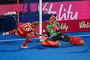 goalkeeper Jackie Briggs of the USA (31)saves a shot from captain Alex Danson of England (15) during the Vitality Hockey Women's World Cup 2018 Pool B match between the USA and England at the Lee Valley Hockey and Tennis Centre, QE Olympic Park, United Kingdom on 25 July 2018. Picture by Martin Cole.