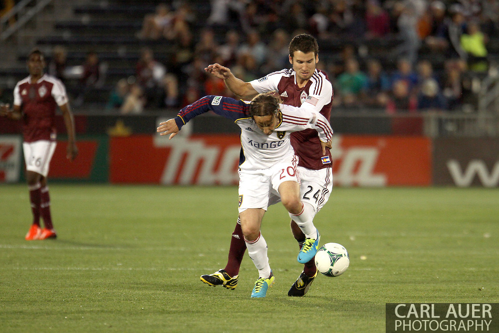 August 3rd, 2013 - Real Salt Lake midfielder Ned Grabavoy (20) attempts to keep control of the ball from Colorado Rapids midfielder Nathan Sturgis (24) in the first half of action in the Major League Soccer match between Real Salt Lake and the Colorado Rapids at Dick's Sporting Goods Park in Commerce City, CO