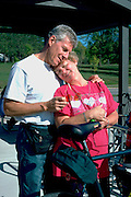 Spouses age 55 embracing along The Great River State Park Bike Trail.  Onalaska  Wisconsin USA
