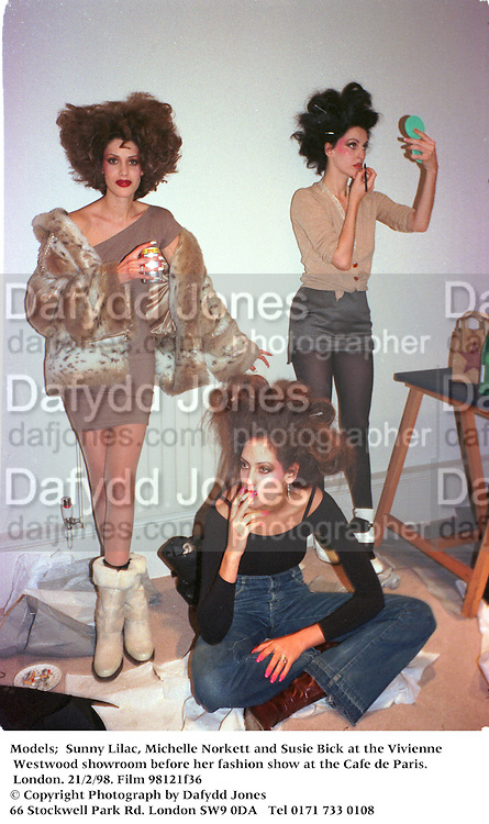 Models;  Sunny Lilac, Michelle Norkett and Susie Bick at the Vivienne Westwood showroom before her fashion show at the Cafe de Paris. London. 21/2/98. Film 98121f36<br />
