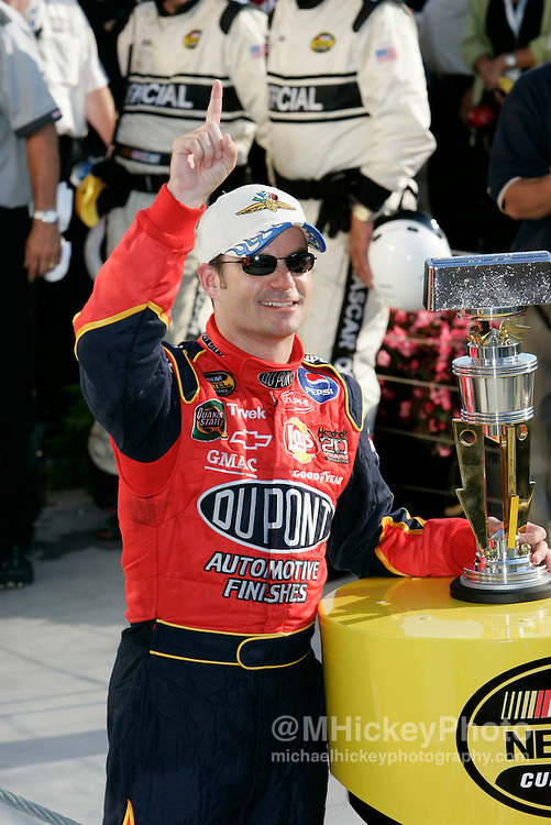 Jeff Gordon poses with his trophy for winning the Brickyard 400