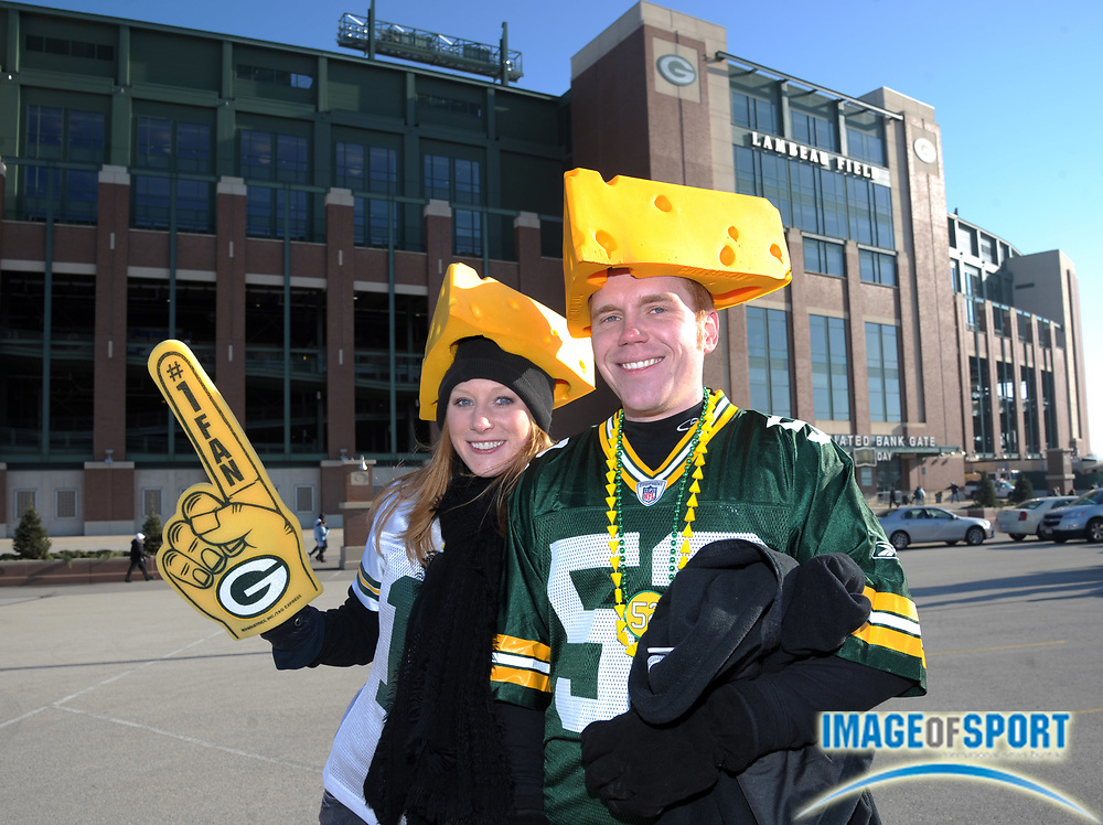 Dec 11, 2011; Green Bay, WI, USA; Green Bay Packers fans Krysta Butkus (left) and Dan Benson wear cheeseheads during tailgate festivities before the game against the Oakland Raiders at Lambeau Field.