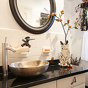 WILMINGTON, DE - AUGUST 8, 2016: Keeping with the garden theme of the property, the first floor en suite full bathroom next to the guest room has frog drawer pulls. 19 Crestfield Road, Wilmington, DE. Credit: Albert Yee for The New York Times