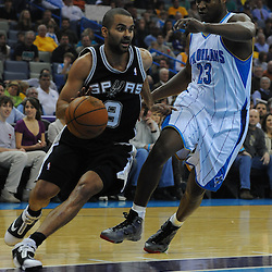 Jan 18, 2010; New Orleans, LA, USA; San Antonio Spurs guard Tony Parker (9) drives past New Orleans Hornets guard Devin Brown (23) during the first half at the New Orleans Arena. Mandatory Credit: Derick E. Hingle-US PRESSWIRE