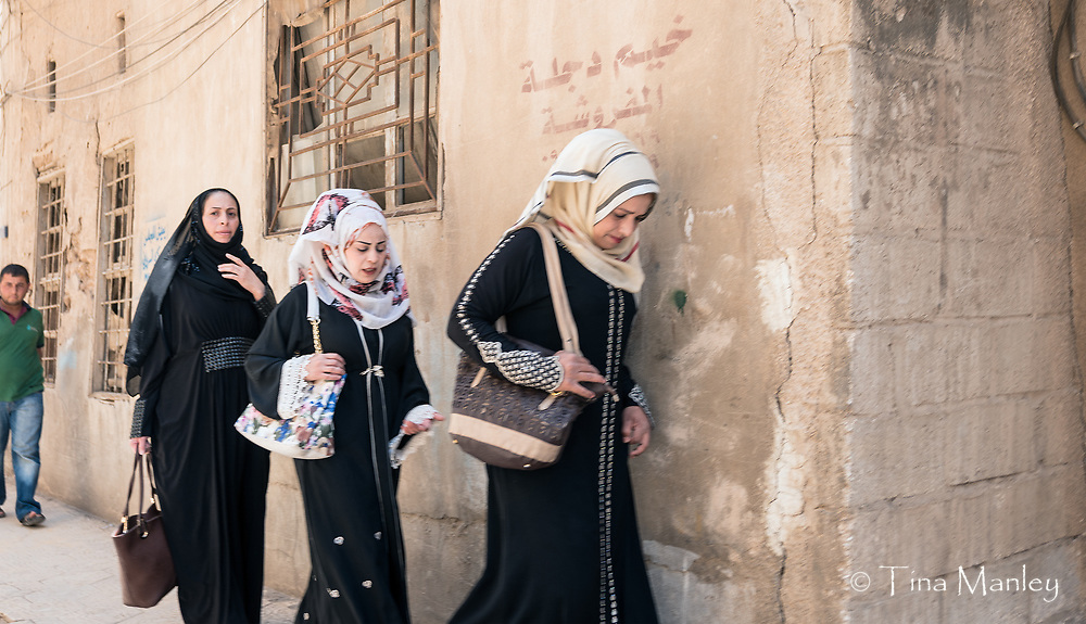 Muslim women in this area wear very large, white or off-white hijabs.