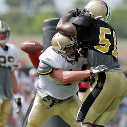 04 August 2009:Llinebacker Jonathan Vilma (51) works against fullback Heath Evans (44) on a pass protection drill during New Orleans Saints training camp at the team's practice facility in Metairie, Louisiana.