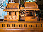 02 NOVEMBER 2016 - BANGKOK, THAILAND:  A large completed spirit house in the workshop. All of the work is done by hand. There used to be 10 families making traditional spirit houses out of teak wood in Ban Fuen, a community near Wat Suttharam in the Khlong San district of Bangkok. The area has been gentrified and many of the spirit house makers have moved out, their traditional wooden Thai houses replaced by modern apartments. Now there is just one family making the elaborate spirit houses. The spirit houses are made by hand. It takes three days to make a small one and up to three weeks to make a large one. Prices start at about $90 (US) for a small one. The largest, most elaborate ones can cost over $1,000 (US). Almost every home and most commercial buildings in Thailand have a spirit house, which is a shrine to the protective spirit of a the land. Spirit houses are also common in Burma, Cambodia, and Laos.       PHOTO BY JACK KURTZ