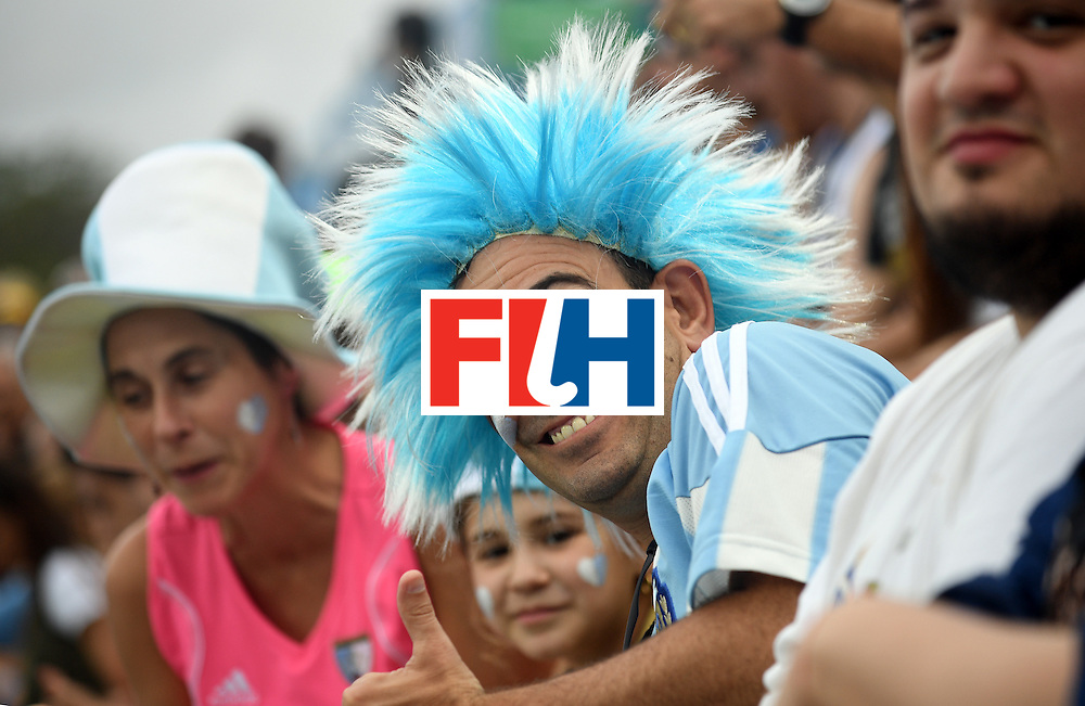 An Argentina fan poses during the men's Gold medal field hockey Belgium vs Argentina match of the Rio 2016 Olympics Games at the Olympic Hockey Centre in Rio de Janeiro on August 18, 2016. / AFP / MANAN VATSYAYANA        (Photo credit should read MANAN VATSYAYANA/AFP/Getty Images)