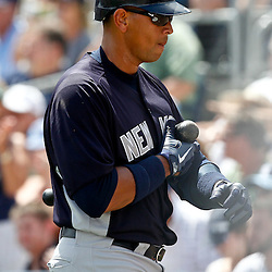 March 21, 2012; Port Charlotte, FL, USA; New York Yankees third baseman Alex Rodriguez (13) reacts after striking out during the top of the first inning of a spring training game against the Tampa Bay Rays at Charlotte Sports Park.  Mandatory Credit: Derick E. Hingle-US PRESSWIRE
