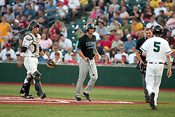 "1 June 2010: Mike Sullivan walks towards the bat boy with a bat. The Windy City Thunderbolts are the opponents for the first home game in the history of the Normal Cornbelters in the new stadium coined the ""Corn Crib"" built on the campus of Heartland Community College in Normal Illinois."