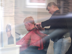 Barber giving haircuts despite lockdown, 14 May 2020<br />