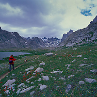 Hiker, backpacker in the Titcombe Basin. Wind River Wilderness Area, Wyoming.