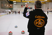 Barry Ivy of Livermore directs his team during the San Francisco Bay Area Curling Club's Tuesday night league at Sharks Ice in San Jose on Jan.15, 2013.