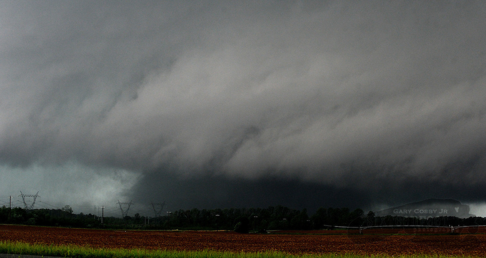 Daily Photo by Gary Cosby Jr...A large tornado, rated as an EF5, sweeps through Limestone County near Ingram Rd. Wednesday afternoon, April 27, 2011.  The twister was on the ground through at least four north Alabama counties including Limestone County where this photo was taken.