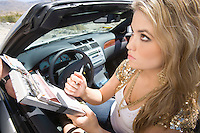 Young woman signing driving ticket