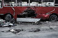 SYRIA, ALEPPO. A damaged bus targeted with a Rocket Propelled Granade in Bustan Al Bashar neighborhood in Aleppo. ALESSIO ROMENZI