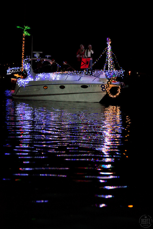 """Ventura Harbor 2009 Parade of Lights """"Holiday Tropical Tiki Party"""". Boats decorated in Holiday lights on parade."""