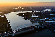 Nederland, Zuid-Holland, Rotterdam, 07-02-2018; Van Brienenoordbrug over de Nieuwe Maas,  skyline Rotterdam. Renovatie van de Van Brienenoordbrug, de westelijke boogbrug wordt versterkt want verzwakt door toenemend zwaar verkeer.<br /> Van Brienenoord bridge crossing the New Meuse near Rotterdam.<br /> <br /> luchtfoto (toeslag op standard tarieven);<br /> aerial photo (additional fee required);<br /> copyright foto/photo Siebe Swart