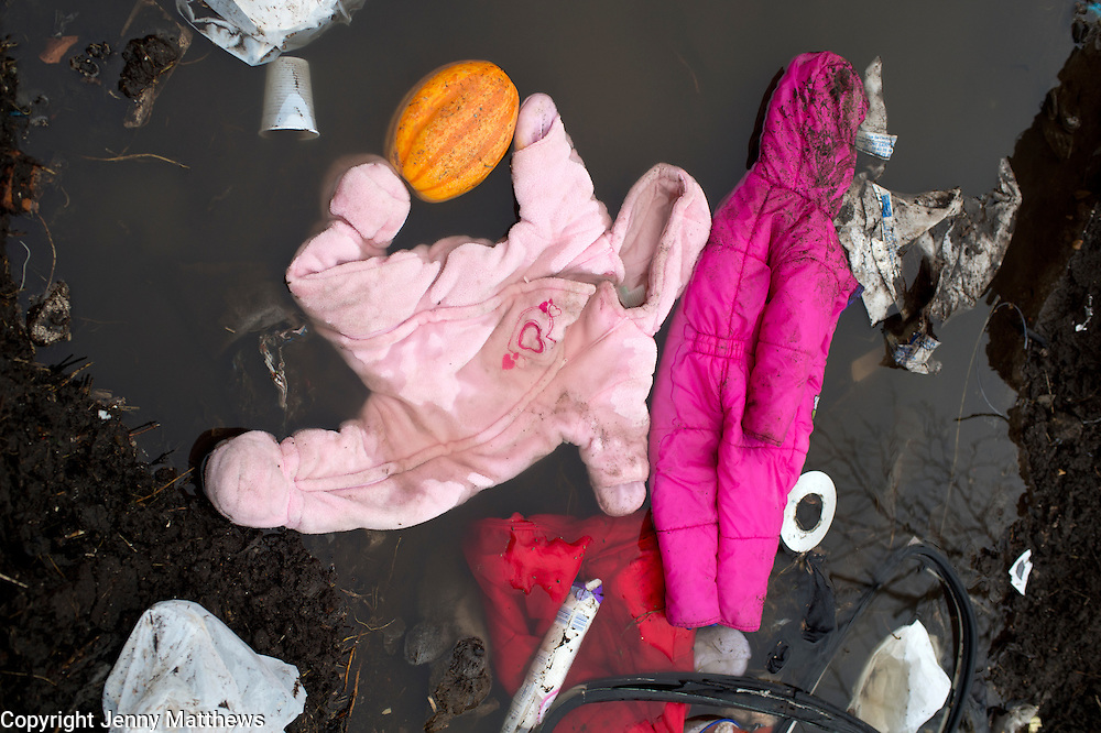 France, Calais. 'Jungle' camp for refugees. Abandonned childrens' clothing in a ditch.