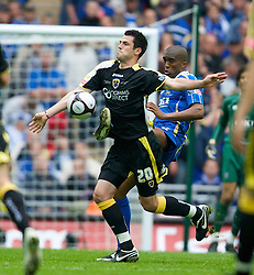 LONDON, ENGLAND - Saturday, May 17, 2008: Cardiff City's Steven Thompson and Portsmouth's Sylvain Distin during the FA Cup Final at Wembley Stadium. (Photo by David Rawcliffe/Propaganda)