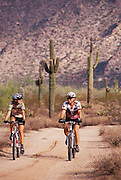 Cyclists ride Sonoran Loop Bicycle Track, White Tank Mtn. Park, Maricopa Co., Arizona..Subject photograph(s) are copyright Edward McCain. All rights are reserved except those specifically granted by Edward McCain in writing prior to publication...McCain Photography.211 S 4th Avenue.Tucson, AZ 85701-2103.(520) 623-1998.mobile: (520) 990-0999.fax: (520) 623-1190.http://www.mccainphoto.com.edward@mccainphoto.com.