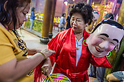 09 FEBRUARY 2014 - HAT YAI, SONGKHLA, THAILAND: A woman gets ready to perform with a lion dance troupe during Lunar New Year in the Tong Sia Siang Tueng temple in Hat Yai. Hat Yai was originally settled by Chinese immigrants and still has a large ethnic Chinese population. Chinese holidays, especially Lunar New Year (Tet) and the Vegetarian Festival are important citywide holidays.     PHOTO BY JACK KURTZ