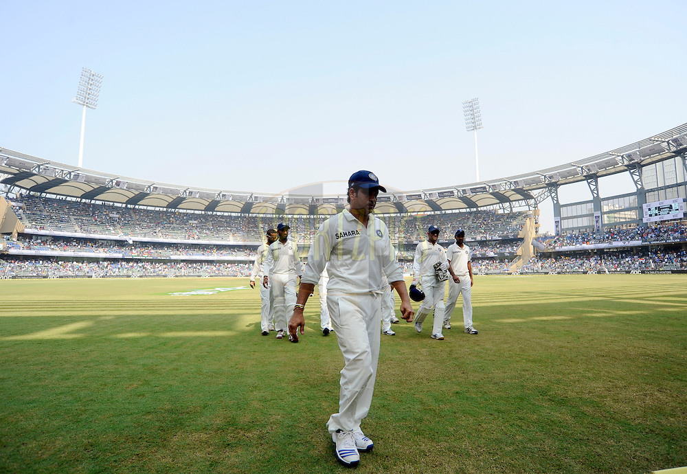 Sachin Tendulkar of India waves to the crowd as he walks back during the lunch break on day one of the second Star Sports test match between India and The West Indies held at The Wankhede Stadium in Mumbai, India on the 14th November 2013<br /> <br /> This test match is the 200th test match for Sachin Tendulkar and his last for India.  After a career spanning more than 24yrs Sachin is retiring from cricket and this test match is his last appearance on the field of play.<br /> <br /> Photo by: Pal PIllai - BCCI - SPORTZPICS<br /> <br /> Use of this image is subject to the terms and conditions as outlined by the BCCI. These terms can be found by following this link:<br /> <br /> http://sportzpics.photoshelter.com/gallery/BCCI-Image-Terms/G0000ahUVIIEBQ84/C0000whs75.ajndY