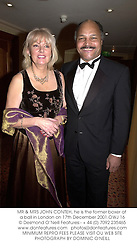 MR & MRS JOHN CONTEH, he is the former boxer at a ball in London on 17th December 2001.OWJ 16