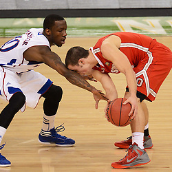 Mar 31, 2012; New Orleans, LA, USA; Ohio State Buckeyes guard Aaron Craft (4) holds the ball away from Kansas Jayhawks guard Tyshawn Taylor (10) during the first half in the semifinals of the 2012 NCAA men's basketball Final Four at the Mercedes-Benz Superdome. Mandatory Credit: Derick E. Hingle-US PRESSWIRE