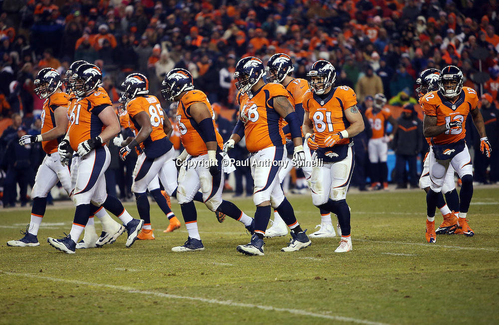 The Denver Broncos offense breaks from the huddle and heads to the line of scrimmage during the 2015 NFL week 16 regular season football game against the Cincinnati Bengals on Monday, Dec. 28, 2015 in Denver. The Broncos won the game in overtime 20-17. (©Paul Anthony Spinelli)