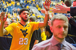 Jan 24, 2017; Morgantown, WV, USA; West Virginia Mountaineers forward Esa Ahmad (23) celebrates with fans after beating the Kansas Jayhawks at WVU Coliseum. Mandatory Credit: Ben Queen-USA TODAY Sports