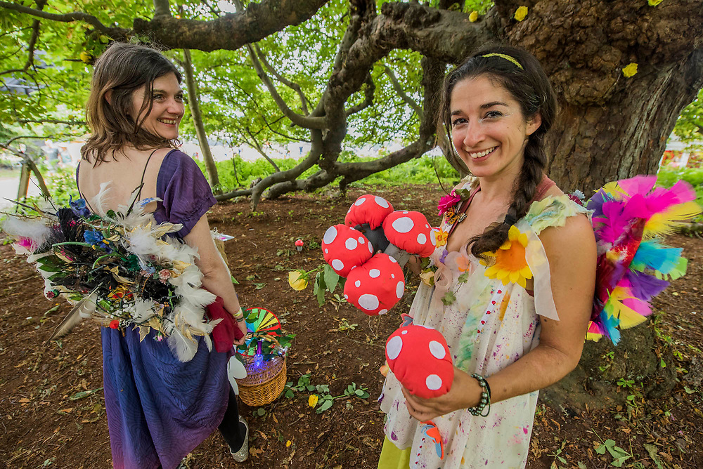 As part of  theWellcomeTrust Area, Faraway Forest faerie folk show visitors the hidden secrets of the forest (assisted by Emily Goss - pictured blue drees - , author of Go Wild! Over 200 Ways to Connect With Nature and The Crop Club). They help[ people identify wildflowers, go cloudwatching and demonstrate recycled crafting . The 2017 Latitude Festival, Henham Park. Suffolk 16 July 2017
