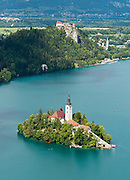 The town of Bled and glacially formed Lake Bled (Slovene: Blejsko jezero) are popular tourist sites in the Julian Alps in northwestern Slovenia. A medieval castle stands above the lake on the north shore, the former seat of the Austrian Bishops of Brixen. The lake surrounds Bled Island (Blejski otok, the only natural island in Slovenia), upon which stands the Pilgrimage Church of the Assumption of Mary (Slovenian: Cerkev Marijinega vnebovzetja), built in the 15th century and now popular for romantic weddings. Lake Bled hosted the World Rowing Championships in 1966, 1979, 1989, and 2011. The lake is 35 kilometers from Ljubljana International Airport.