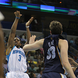 Jan 20, 2010; New Orleans, LA, USA; New Orleans Hornets guard Chris Paul (3) shoots over Memphis Grizzlies center Marc Gasol (33) during the second half at the New Orleans Arena. The Hornets defeated the Grizzlies 113-111. Mandatory Credit: Derick E. Hingle-US PRESSWIRE