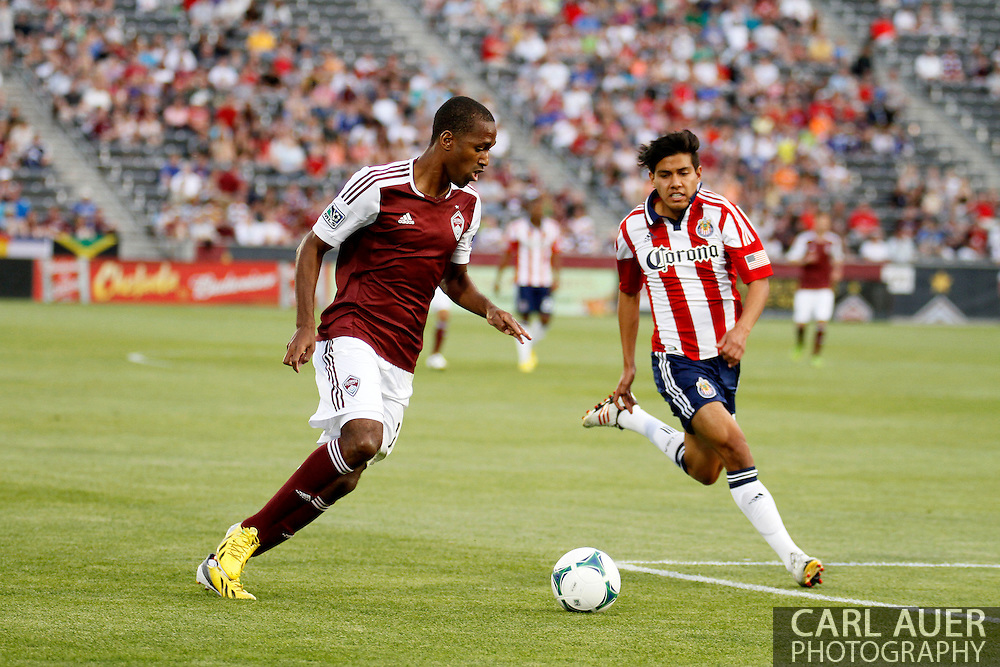 May 25th, 2013 Commerce City, CO - Colorado Rapids midfielder Atiba Harris (16) looks to pass the ball past Chivas USA midfielder Josue Soto (13) in first half action of the MLS match between Chivas USA and the Colorado Rapids at Dick's Sporting Goods Park in Commerce City, CO