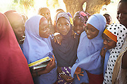Jaria Issa, 14 years old, stands outside her college with other students in the village of Dogo, Zinder Province, Niger on October 14, 2014.