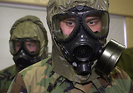 FORT DIX, NJ. - JANUARY 8:  Matthew O'Neil (R), of Baltimore, Maryland, and Josiah Saxe (L), of Altoona, Pennsylvania, of the 300th Chemical Company, train in the use of their gas masks, January 8, 2003, at Fort Dix Military Reservation, in Fort Dix, New Jersey. More than 13,648 soldiers have swept through Fort Dix in the past year, with new units arriving weekly for mobilization or demobilization in support of Operations Noble Eagle and Enduring Freedom. (Photo by William Thomas Cain/Getty Images)