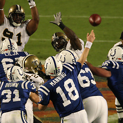 2010 February 07: Indianapolis Colts quarterback Peyton Manning (18) throws past New Orleans Saints defensive end Will Smith (91) and defensive end Anthony Hargrove (69) during a 31-17 win by the New Orleans Saints over the Indianapolis Colts in Super Bowl XLIV at Sun Life Stadium in Miami Gardens, Florida.